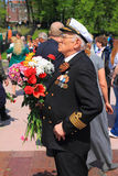 The veteran with flowers in the Victory Day Royalty Free Stock Photo