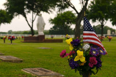 Veteran Funeral. An American Flag marking the grave of a deceased veteran Royalty Free Stock Image