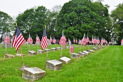 Veteran Grave Sites. World War II Veteran Grave Sites with an American Flags Royalty Free Stock Photos