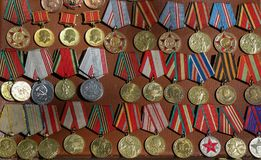 Veteran medals from Georgia. Veteran medals for their labour scattered on a table Royalty Free Stock Images