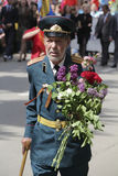 The veteran of operations with flowers on parade to the Victory Stock Photos