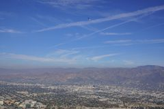 Veteran's Day US Army Performance with skydiver. And American flag, saw on Hollywood sign trail at Hollywood, California, United States Royalty Free Stock Photo