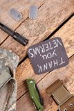 Veteran`s essentials on wood, flat lay. Top view. Thank you veterans Stock Image