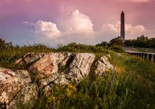 Veteran`s Monument marks the top of NJ, with a stormy sunset in High Point State Park,. Stormy sunset over the mountains at High Point State Park, the top of NJ royalty free stock images