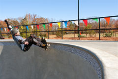 Veteran Skateboarder Grinds Along Top Of Big Bowl Royalty Free Stock Images