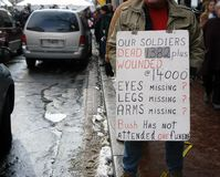 Veteran soldier protesting with sign. At the inauguration of George W Bush. Number of dead and wounded on sign Stock Image