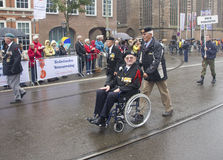 Veteran in Wheelchair. THE HAGUE, HOLLAND - JUNE 25, 2011: Veteran in wheelchair in the annual Veterans Day parade on June 25 in The Hague, Holland Royalty Free Stock Image