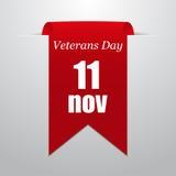 Veterandag November 11th Röd etikett på en grå bakgrund Arkivfoto