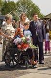 Veteranenfrau mit ihrer Familie während Victory Day-Feier Stockfotografie