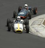 Veteranos: Carros de corridas da fórmula 3 que cortam no gancho de cabelo Foto de Stock Royalty Free