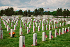 Veterans Cemetery On Memorial Day. Flags are placed at each veteran's headstone on Memorial Day Stock Photography