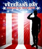 Veterans Day American Saluting Soldier. American saluting soldier with a patriotic Veterans Day red, white and blue flag background Stock Photos