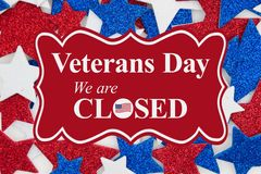 Veterans Day closed message with red, white and blue glitter stars
