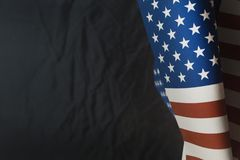 The Veterans Day concept united states of America flag on black