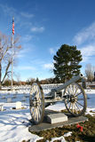 Veterans Day Image. A view of the military section of a historical graveyard depicts the perfect Veterans Day image - a cannon, military grave markers, and a royalty free stock image