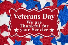 Veterans Day message with red, white and blue glitter stars