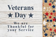 Veterans Day message with stars on a weathered whitewash wood