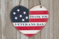 Veterans Day message. Thank You Veterans Day message on a retro USA flag on a heart shape wood sign on weathered wood Stock Photography