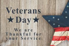 Veterans Day message. Veterans Day we are thankful for your service text with USA patriotic old star on a weathered wood stock photos