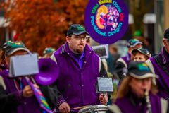 Veterans Day Parade 2017. Portland, Oregon, USA - November 11, 2017: The Beat Goes On Marching Band in the annual Ross Hollywood Chapel Veterans Day Parade, in royalty free stock images
