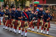 Veterans Day Parade 2017. Portland, Oregon, USA - November 11, 2017: Portland Police Highland Guard Pipe Band in the annual Ross Hollywood Chapel Veterans Day royalty free stock photography