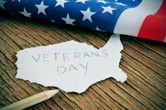 Veterans Day. A piece of paper in the shape of United States with the word Veterans Day stock photography