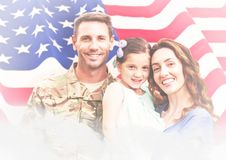 Veterans day soldier with family in front of flag. Digital composite of veterans day soldier with family in front of flag stock image
