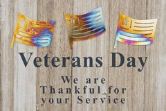 Veterans Day message with metal flags on wood royalty free stock images