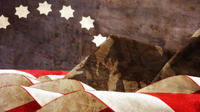 Veterans. Flag Waves Mimetic. Mountains and Stars Stock Photo