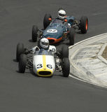 Veterans:Formula 3 Race Cars dicing in the hairpin. Car 36: 1962 Brabham BT2; Car 92: 1963 MRC 22/63 Formula 3 Veterans on the race track at the Hampton Downs royalty free stock photo