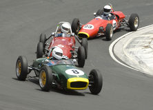 Veterans:Formula 3 Race Cars dicing in the hairpin. Car 8: 1960 Lotus 8; Car 48: 1960 Auto Sud; Car 23: 1962 Elfin Catalina. Formula 3 Veterans on the race track Royalty Free Stock Photography