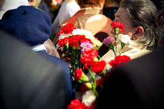 Veterans give flowers to the day of victory on May 9 Royalty Free Stock Photo