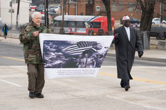 Veterans March in Martin Luther King Jr. Day Parade. Washington, DC - January 16, 2017: Veterans holding sign and marching in the Martin Luther King, Jr. Day royalty free stock photography