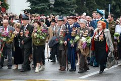 Veterans of military operations on the Victory Day parade. Pyatigorsk, Russia. Pyatigorsk, Russia - May 9, 2018: Veterans of military operations with medals in Royalty Free Stock Image