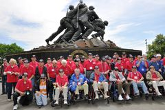 Veterans at a monument Royalty Free Stock Photos