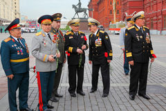 Veterans near monument to military commander Stock Image