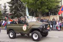 Veterans onboard the military car on parade in honor of the 69th Stock Image
