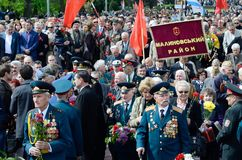 Veterans of Second World War coming to lay flowers at Uknown Seaman  Monument in a commemoration of Soviet warriors on Victory Day Royalty Free Stock Photos