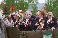 Veterans on Victory parade. In military truck Stock Photo