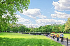 Veterans in Vietnam Veterans Memorial in Washington DC. Washington DC, USA - May 2, 2015: Tourists and War Veterans and guardians of Honor Flight nonprofit Royalty Free Stock Photo