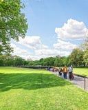 Veterans at Vietnam Veterans Memorial in Washington DC. Washington DC, USA - May 2, 2015: Tourists and War Veterans and guardians of Honor Flight nonprofit Stock Image