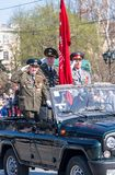 Veterans of World War 2 salute from SUV on parade Stock Image