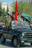 Veterans of World War 2 salute from SUV on parade Stock Photo