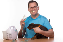 Veterinar and puppy  with inhaler with inhaler Stock Images