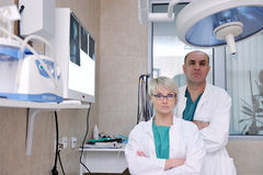 Veterinarian and assistant in animal clinic Stock Images