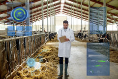 Veterinarian with cows in cowshed on dairy farm. Agriculture industry, people and animal husbandry concept - veterinarian or doctor with clipboard and herd of Stock Photography