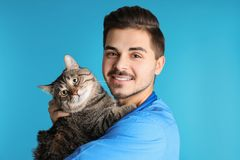 Veterinarian doc with cat. On color background royalty free stock images