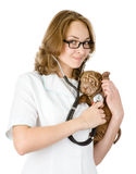 Veterinarian doctor making a checkup of a sharpei puppy dog. Royalty Free Stock Photography