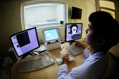 Veterinarian doctor with MRI computer control Stock Photo