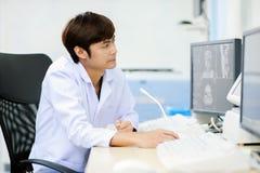Veterinarian doctor working in MRI room Stock Photos